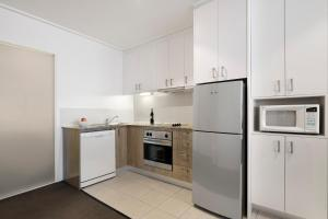 A kitchen or kitchenette at Quest Jolimont