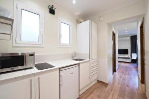 Kjøkken eller kjøkkenkrok på Apartamentos Atica