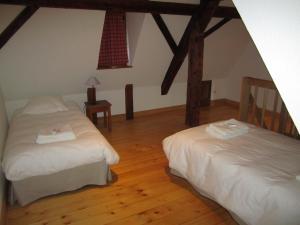 Un ou plusieurs lits dans un hébergement de l'établissement Gîte Bei der Kirche
