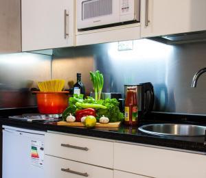 A kitchen or kitchenette at Heidelberg Haus Apart Hotel