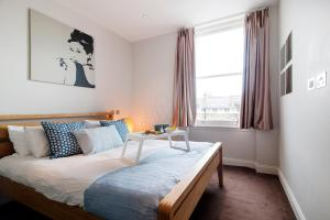 A bed or beds in a room at The Fulham Road Residence