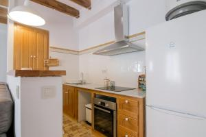A kitchen or kitchenette at Apartmento Chic