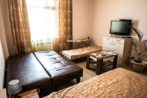 Телевизор и/или развлекательный центр в Gorkavich Apartment