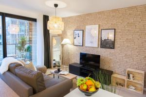 A seating area at Sweet Inn Apartments -EU Commission