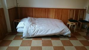 Un ou plusieurs lits dans un hébergement de l'établissement Villa Marguerite