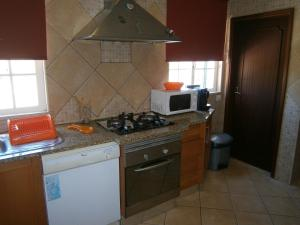 A kitchen or kitchenette at holiday`house
