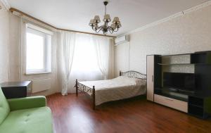 Кровать или кровати в номере Аpartment on Maykla Lunna