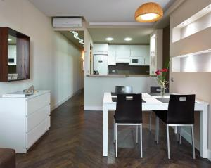 A kitchen or kitchenette at Gaudint Barcelona Suites