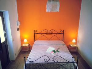 A bed or beds in a room at Il Piccolo Baglio