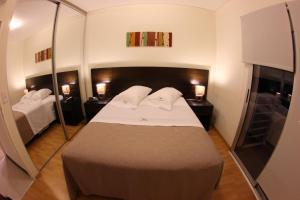 A bed or beds in a room at Lecer