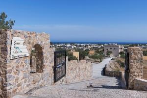 The surrounding neighborhood or a neighborhood close to the villa