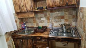 A kitchen or kitchenette at Machanents apartment