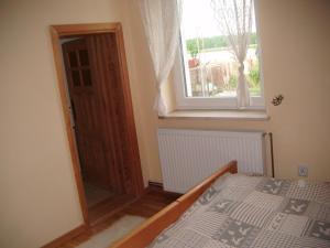 A bed or beds in a room at Apartament Wolin koło Międzyzdrojów