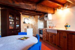 A kitchen or kitchenette at Moinho da Camila