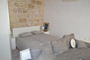 Krevet ili kreveti u jedinici u objektu Apartments Martinis