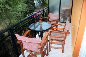 A balcony or terrace at Johny's Studios