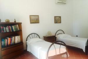 Um quarto em Casa Vacanze Villa Martino