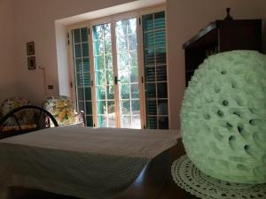 Uma cama ou camas num quarto em Casa Vacanze Villa Martino