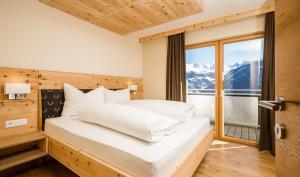 Un ou plusieurs lits dans un hébergement de l'établissement Luxapart