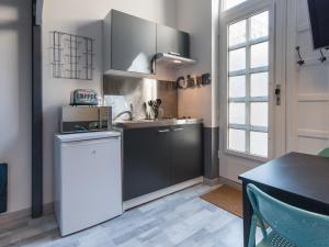 Küche/Küchenzeile in der Unterkunft Appartement Ledin - Saint Etienne City Room