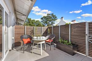 A porch or other outdoor area at Glebe Self-Contained Modern One-Bedroom Apartment (6 COW)
