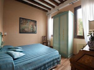 A bed or beds in a room at San Giacomo