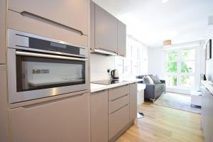 Cucina o angolo cottura di Valet Apartments Bruges Place Camden
