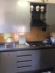 A kitchen or kitchenette at Corallo Apartment