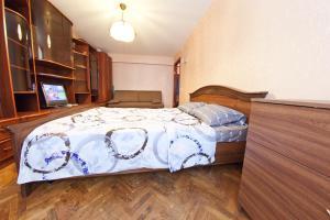 Кровать или кровати в номере Fili Apartment