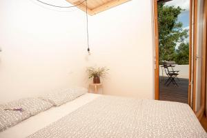 Postelja oz. postelje v sobi nastanitve Apartment Oton Reya