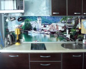 A kitchen or kitchenette at Apartments on Gorkogo 10