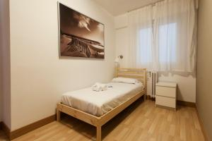 A bed or beds in a room at Zuhaitz - Basque Stay