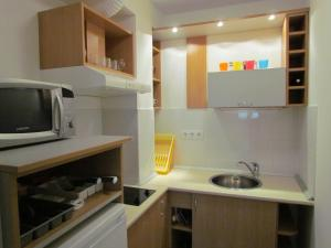 A kitchen or kitchenette at Taban Apartment