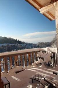 Balcon ou terrasse dans l'établissement Chalet Eterlou