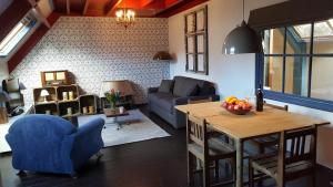 Coin salon dans l'établissement Lant van Beloften