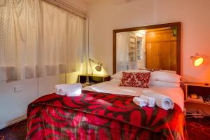 A bed or beds in a room at The Last Villa