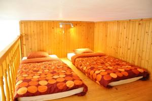 A bed or beds in a room at Traditional Slovak Apartment