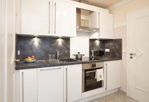 Küche/Küchenzeile in der Unterkunft Die kleine Seerose
