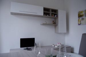 A television and/or entertainment center at Appartamento Parella