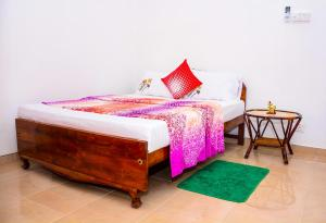 A bed or beds in a room at Lakshmi Family Villa