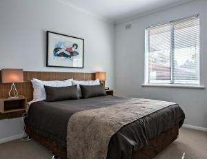 Una habitación en Adelaide DressCircle Apartments - Childers Street