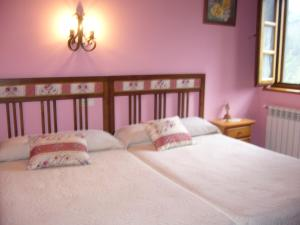 A bed or beds in a room at Casa Maseda