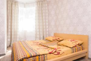 """Кровать или кровати в номере """"SelimVseh"""" Apartment at Soyuznaya"""