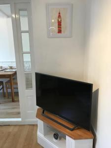 A television and/or entertainment center at Parsons Green garden flat