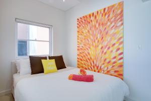 A bed or beds in a room at Bondi Beachfront Penthouse Apartment