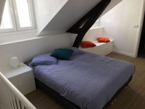 En eller flere senge i et værelse på Les Petits Carreaux