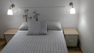A bed or beds in a room at Madrid Rent 3