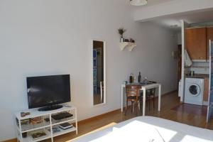 A television and/or entertainment center at Panoramic Charming Studio