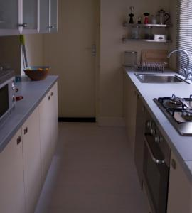 A kitchen or kitchenette at Collingwood House Tynemouth