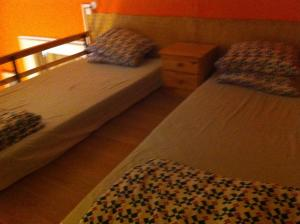 A bed or beds in a room at Gallery Stay Hostel and Apartments